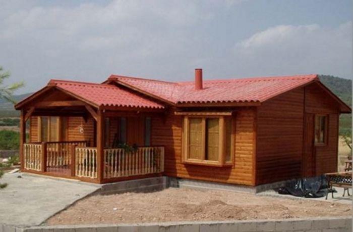 Ejemplos de fachadas de casas de madera y claves a tener for Casas de madera baratas pequenas